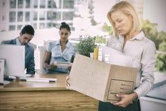Smutny bizneswoman opuszcza biuro po być pozwalał iść zdjęcie stock