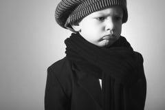 Smutny Little Boy w nakrętce. Stylowy dzieciak Fotografia Royalty Free