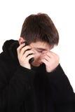 Smutny nastolatek z telefonem komórkowym Zdjęcie Stock