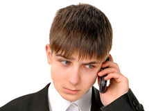 Smutny nastolatek z telefonem komórkowym Zdjęcia Royalty Free