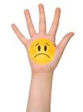 Smutny twarzy ikony obraz na ręce Fotografia Royalty Free