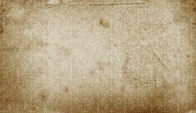 Smutsa ner gammal pappers- bakgrund med tappningprydnaden Royaltyfri Foto