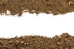 Smutsa ner jord på vit bakgrund Royaltyfria Foton