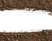 Smutsa ner jord på vit bakgrund Royaltyfria Bilder