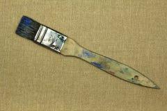 Smutsig borste för målarfärg på kanfas Royaltyfria Foton