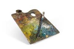 Smutsig och gammal färgpalett med borsten arkivbilder