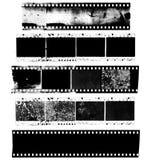 Smutsig, smutsig och skadad remsa av celluloidfilmen royaltyfria bilder