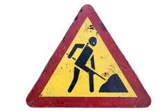 Smutsig triangulär röd isolat för ` för arbeten för väg för ` för gränsgulingvägmärke Royaltyfri Fotografi