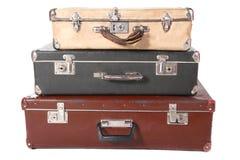 smutsiga dammiga gammala resväskor tre Arkivfoto