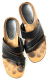 Smutsiga gamla par av lädersandaler över den vita sikten för hög vinkel Royaltyfri Fotografi