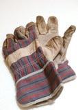 smutsiga handskar royaltyfri bild