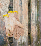 smutsiga handskar Arkivfoto