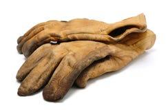 smutsiga handskar piskar gammalt arbete Arkivfoton