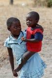 Smutsiga och fattiga namibiska barn Fotografering för Bildbyråer