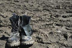 smutsiga skor Fotografering för Bildbyråer