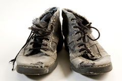 smutsiga skor Arkivbilder