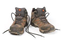 Smutsiga skor, trekking känga. Arkivfoto