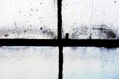 smutsigt grungefönster för bakgrund Arkivfoto