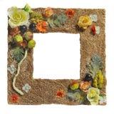 smyckad konstgjord blommaphotoframe Arkivfoto