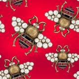 Smycken av en fluga på en röd bakgrund royaltyfri illustrationer