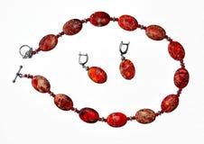 Smycken som göras från den röda jaspisen Royaltyfria Bilder