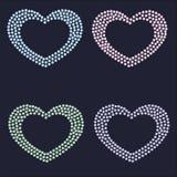 Smyckenuppsättning av hjärtor av olika kristaller och gemstones Arkivfoto