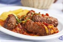 Smyrneika soutzoukakia希腊人食物 免版税库存照片