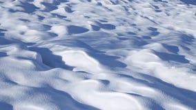 Snö driver på en solig dag Arkivfoto