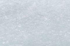 Snö på bilvindrutan Arkivfoto