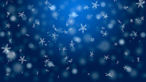 Snö på en blå bakgrund Royaltyfria Foton