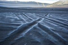 Snö på havet av sand Fotografering för Bildbyråer