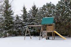 Snö på playset Arkivfoto