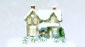Snö som faller runt om mycket litet hus lager videofilmer