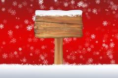 Snö täckte det tomma tecknet på en julsnöflingabakgrund Royaltyfria Bilder
