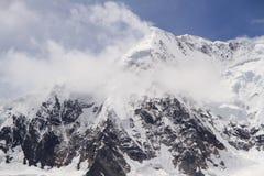 Snöberg, meter av snöberg Arkivfoto