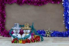 Snödocka på trägolv Fotografering för Bildbyråer