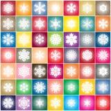 Snöflinga på abstrakt bakgrund för färgrika fyrkanter Royaltyfria Foton