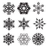 Snöflingor övervintrar uppsättningen av svart isolerade nio symbolskonturnolla Arkivbild