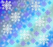 Snöflingor mot en lutning Arkivbild