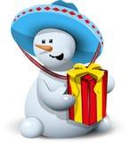 Snögubbe i en sombrero med gåvan Arkivfoto
