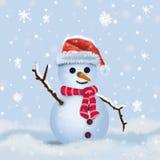 Snögubbe i hatt och halsduk Royaltyfria Bilder