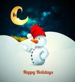 Snögubbe med den Santas hatten i djupfryst vinter Arkivfoto