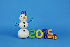 Snögubbe med nummer 2015 Fotografering för Bildbyråer