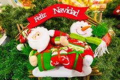 Snögubbe med Santa Claus Fotografering för Bildbyråer