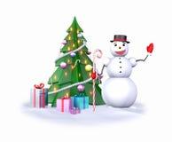 Snögubbe nära julgranen Fotografering för Bildbyråer