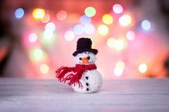 Snögubbe och bokeh Fotografering för Bildbyråer