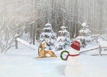 Snögubbe och hjortar med julprydnader Arkivbilder