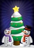 Snögubbe- och kvinnaw-julgran Arkivfoton