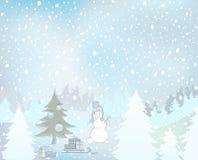 Snögubbe och snöig landskap Royaltyfria Bilder