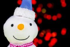 Snögubbe och suddigt ljus Arkivfoton